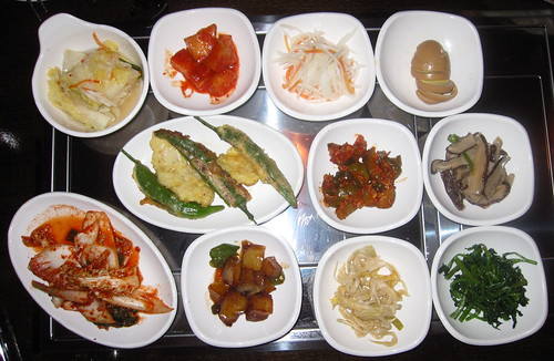 Miga Sides: Pickled Cabbage, Spicy Radish, Pickled Radish, Soy Hard-boiled Egg, Spicy Picked Cucumber, Tempura Peppers & Fish, Kimchi, Roasted Potatoes, Lotus Flower Shoots, & Spinach