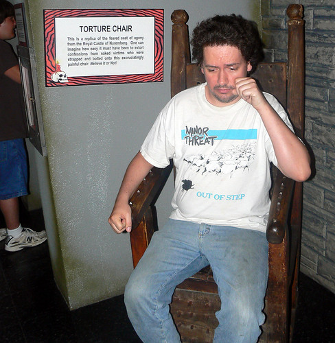 20090805 - Ripley's Believe It Or Not! museum - torture - Clint - sitting on the torture chair - (by Vicky) - 3806546444_9015cb57f3_o