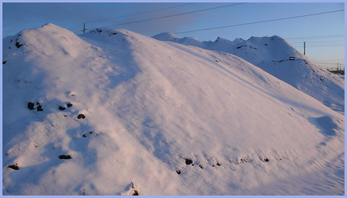 snow-covered mounds of soil and gravel