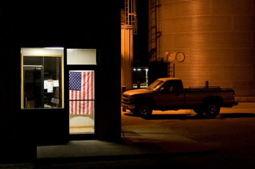 A night-time photo of the office at a grain elevator in Elbow Lake, Minnesota.