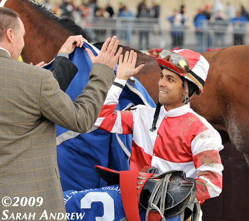 High-five for Shaun Bridgmohan after he won the Cigar Mile with Kodiak Kowboy