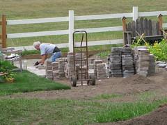 Dick lays bricks