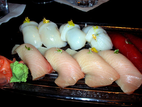 Top: Fresh Giant Sea Scallop from Seattle w/ gold leaf and shiso leaf  Bottom: Super Premium Yellowtail From Tsukiji Tokyo