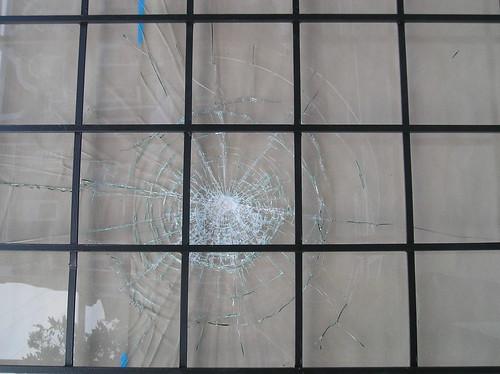 Damaged window, corner store