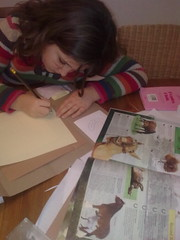 Working on her horses lapbook