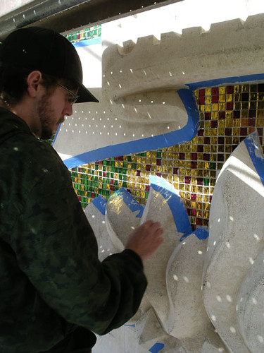 Recent graduate Drew Hutcheson works on detailing the mosaic during the phoenix face-lift project that took place this past June.  Courtesy of Fr. Tom Lucas