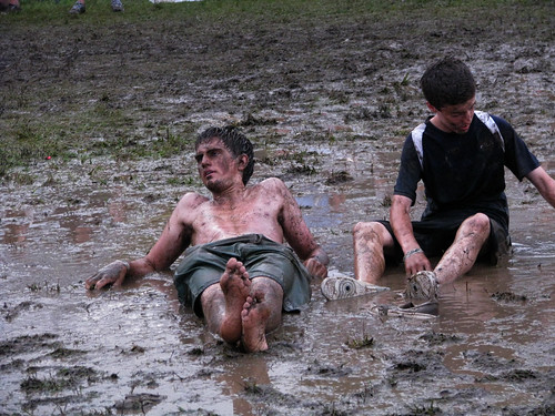 Music fans rest in the mud at All Points West; photo by Jill Menze