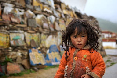 This dirty Tibetan girl probably hasnt seen a bath in months.  Cleanliness isnt a big concern to Tibetans since the cold climate and high altitudes help keep stinky bacteria at bay.  Litang, Tibet (China)