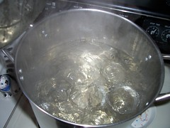 Sterilize the jars and rings in boiling water, add the lids after turning off the heat.