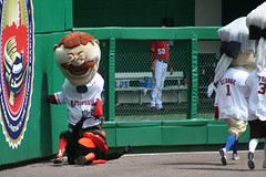 Washington Nationals racing president Teddy Roosevelt knocks down the Baltimore Orioles Bird at Nationals Park.