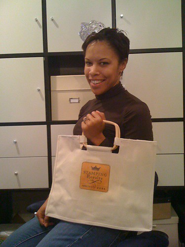 Winner Ashley Newell modeling her Stamping Royalty tiara and tote bag.