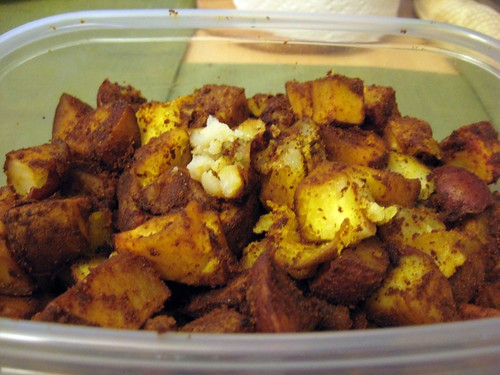 Curry and Tumeric Seasoned Wedges in Storage Container