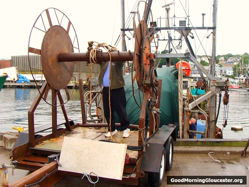 The Stern Of The Boat Lines Up With The Mobile Net Reel