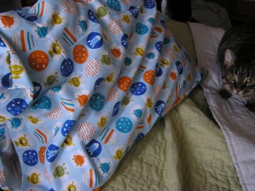 image: alien pillowcase!