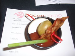 Carmen Owens from Surly Girl Saloon brought a sample of bacon infused vodka Bloody Marys that will be at Too Many Cooks