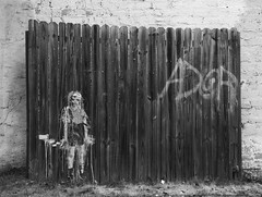 Child with toy hand grenade street art