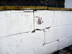 The initial cracks where I got my chisel in - the footmark is where I tried - in vain - to kick the pen over.