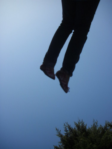 We went to the park down the street. Lauren was swinging.