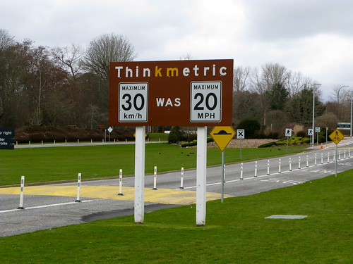 Think Metric sign