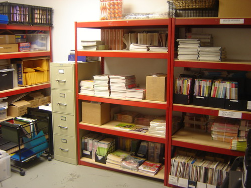 Since were on this side of the building, Ill take you into our storage room. Here we store all of our magazines, supplies, Christmas decorations, etc.