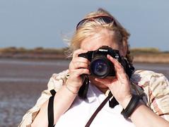 Brenda hiding behind her camera