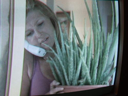 Coach's wife with aloe plant
