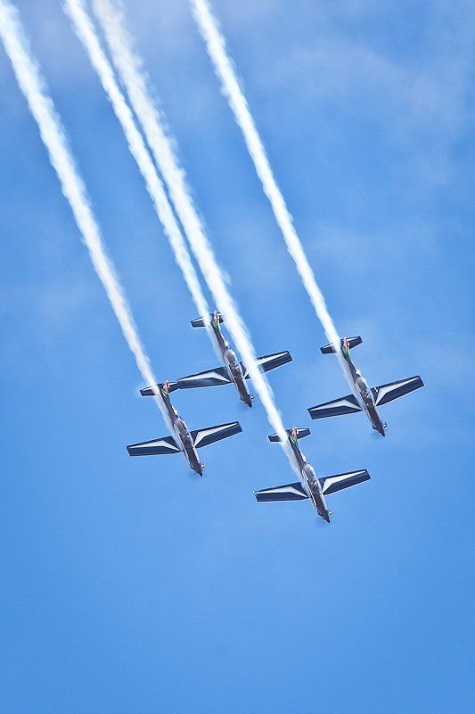 Four Silver Falcon aircraft in diamond formation