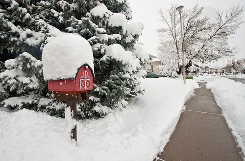an image of a snow covered mailbox