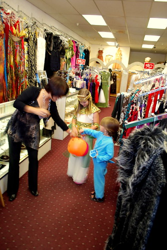 trick or treating in a clothing store