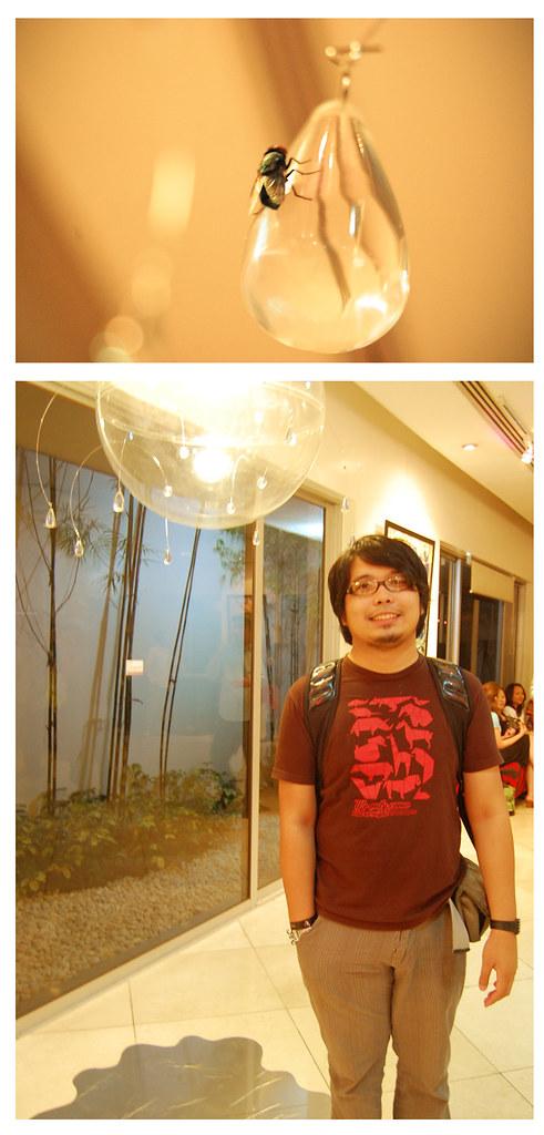 Dan Matutina a.k.a. Twistedfork under his Hot Shower lamp-mobile installion at Versus Manila 2 Design Changes: An Artvocacy Exhibit