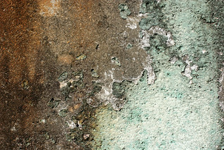 Peeling Paint on Dirty Concrete