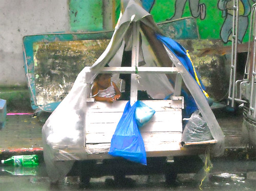 A little Girl in a garbage cart