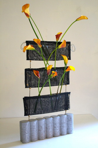 Industrial design with orange calla lillies