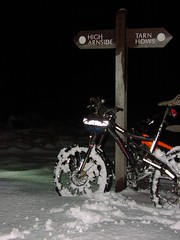 Two bikes and the sign post on Iron Keld, Ambleside.