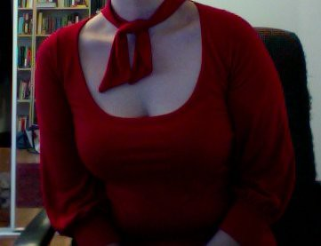 The lack of head keeps the focus on the decolletage.