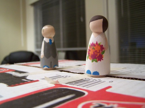 Mini Mr Knit has been clear coated, Mini Miss Knit has not.