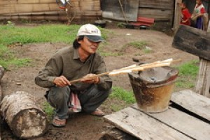 Jackie Chan toasts bread over an open fire for breakfast on our second day of trekking