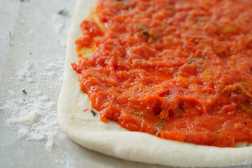 Sauce spread on dough