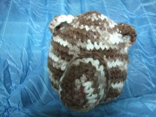 Crocheted sheep's head in variegated browns and white