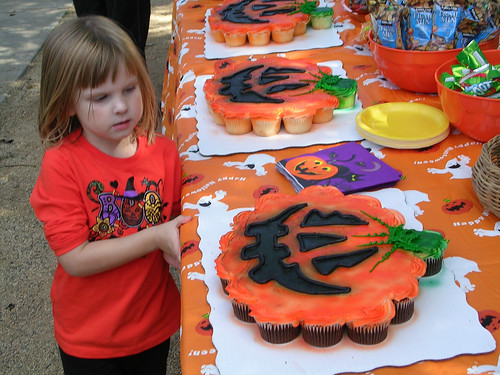 Emma Eying the Pumpkin Cupcakes