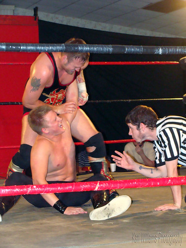 The Rebel Jeremy Wyatt targets LWA Heavyweight Champion K.C. Karringtons arm in their second battle, as Wyatt tries to regain the belt. Photo by Kari Williams