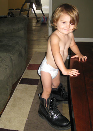 Skyler wearing Daddys motorcycle boots!