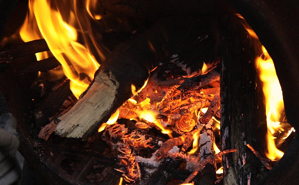 Kindling in an iron potbelly stove.
