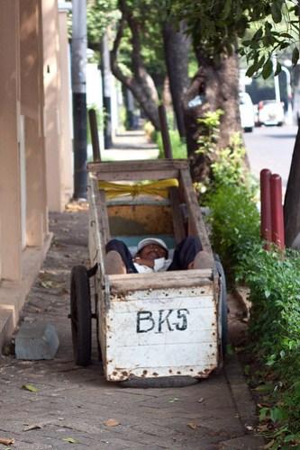 Rubbish man asleep in cart, Menteng