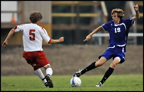 Hickman High School junior forward Connor Hollrah drives the ball past Jefferson City High School senior midfielder Gavin Juckette on Sept. 8 at the Soccer Park in Jefferson City.