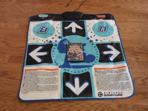 Helping Rooster sell Dance Dance Revolution on Craigslist.