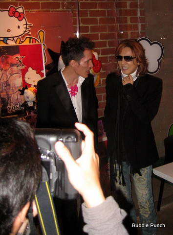 Yoshiki (right) formerly of X-Japan poses with a fan