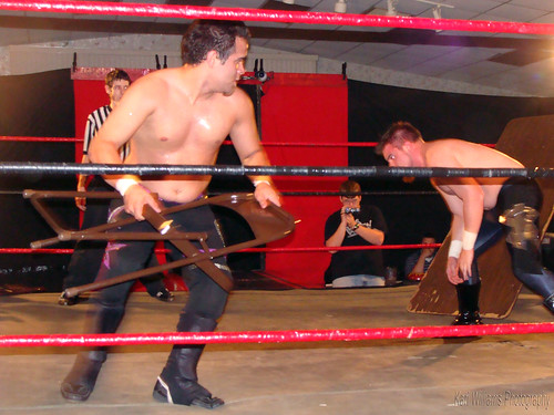 Thee Brandon Espinosa challenges Spoiled Steven Kennedy for Kennedys Medallion of Brutality in a Tables Match. Photo by Kari Williams