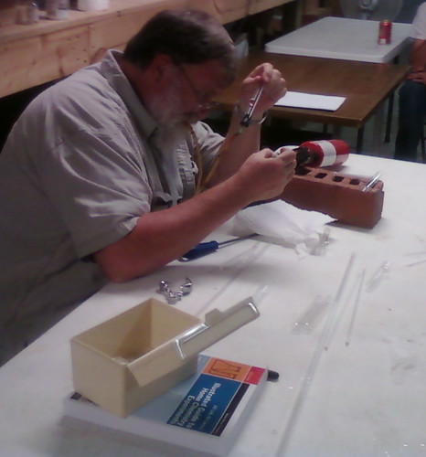 John building a tee connection in two glass tubes.