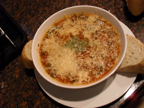 Soup, garnished with pesto and Parmesan